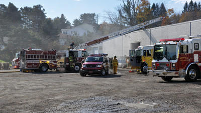 Somerset Volunteer Fire Departments ladder truck was up and working within minutes so firefighters could put out the fire at the Penn Carbose Inc.s building in Somerset. The parking lot soon became full with nearly 50 firefighting crews from several county fire departments.