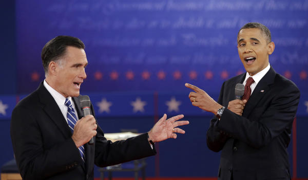 In this Oct. 16 file photo, President Barack Obama and Republican presidential candidate, former Massachusetts Gov. Mitt Romney, exchange views during the second presidential debate at Hofstra University in Hempstead, N.Y.