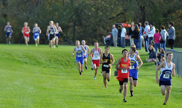 Runners compete during Colonial League's high school cross country championships at DeSales University on Wednesday.
