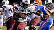 South Carolina taliback Marcus Lattimore, who ran for 212 yards in the Swamp as a freshman in 2010, might not play Saturday against the Gators  because of a hip injury, coach Steve Spurrier said Wednesday.