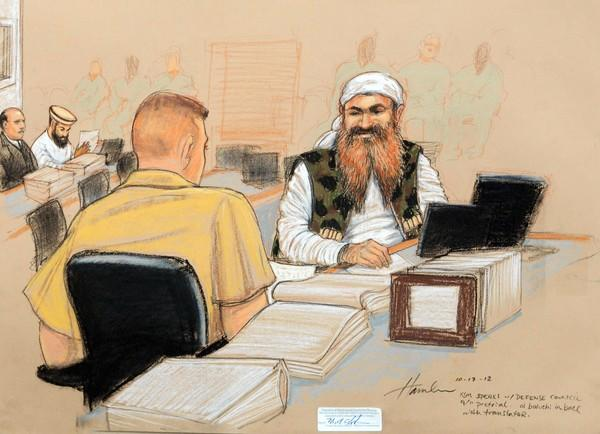 An artist's sketch shows alleged Sept. 11 mastermind Khalid Shaikh Mohammed speaking with a member of his legal team during a pretrial hearing at the U.S. military prison at Guantanamo Bay, Cuba.
