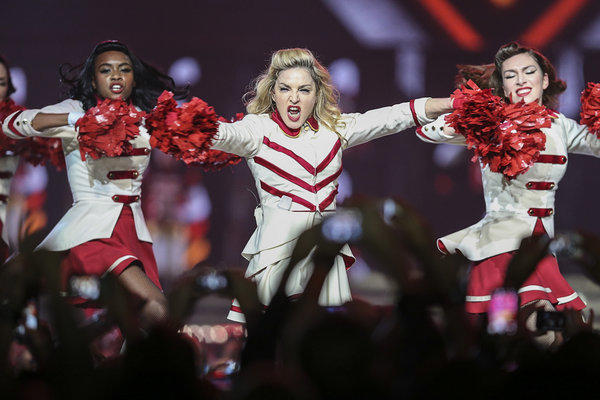 Madonna showed support for Malala Yousafzai, the 14-year-old Pakistani girl shot and critically wounded by the Taliban because of her advocacy for girls' education, while performing at the Staples Center.