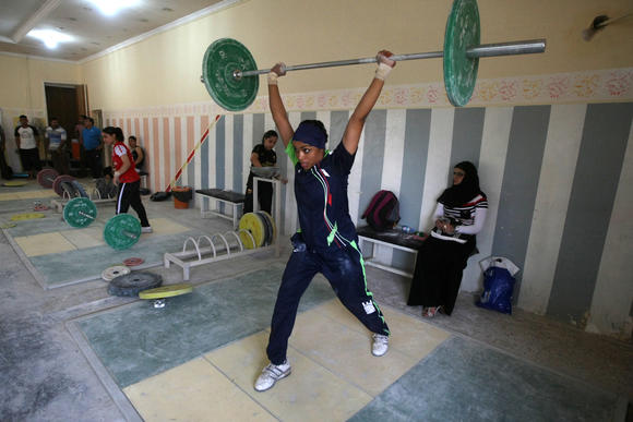 Fifteen-year-old Hoda lifts weights at a gym in Sadr City on September 20, 2012.