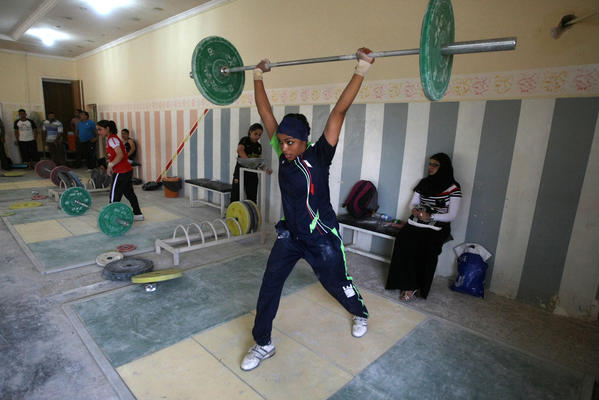 A conservative, Shiite-majority area of Baghdad serves as the unlikely base for Iraq's first female national weightlifting team, which is due to compete in Morocco on September 27.