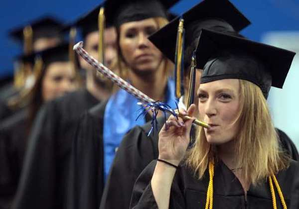 In this May 13, 2012, file photo, Morgan Simpson celebrates her graduation during the processional of the University of Alaska Fairbanks commencement at the Carlson Center in Fairbanks, Alaska