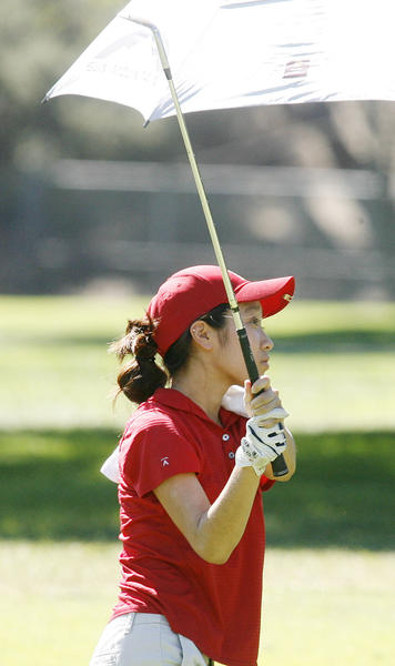 La Canada's Jennifer Kim watches her fairway shot on the second fairway for the Pacific League girls golf championship at Brookside Golf Course in Pasadena on Wednesday, October 17, 2012.