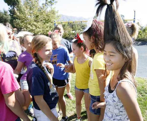 Keiko Segismundo, 11, put her hair up tall as she enjoys herself with her 6th grade friends during recess on wild hair day for Red Ribbon Week at La Canada Elementary School.