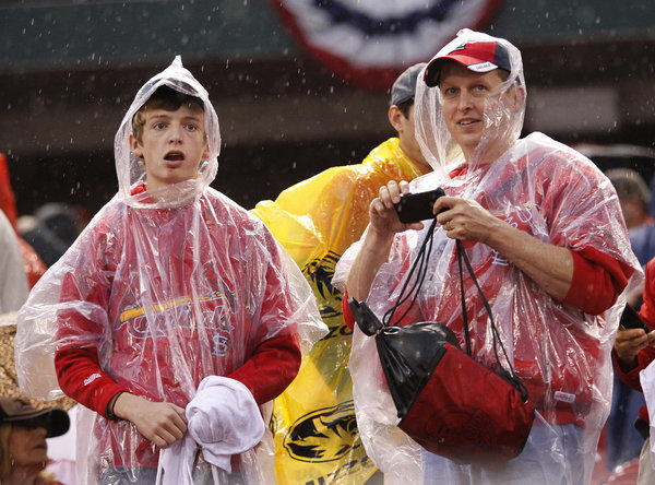 Cardinals fans wait out a 3 1/2-hour rain delay at Busch Stadium on Wednesday night in St. Louis.