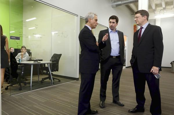 Chicago Mayor Rahm Emanuel, from left, Justyn Howard, CEO of Sprout Social, and Peter Barris, of New Enterprise Associates, on Wednesday toured the building at 600 W. Chicago Ave., where California-based New Enterprise, a venture capital firm, is opening an office.