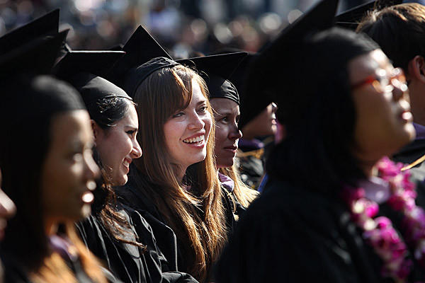 Maria Gomez, center, takes part in graduation ceremonies at UCLA in June 2011. She was receiving her master's degree in architecture.