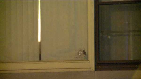 A closeup of the bullet hole in the window of a West Pullman home where a pregnant was injured by flying glass, according to Chicago police.