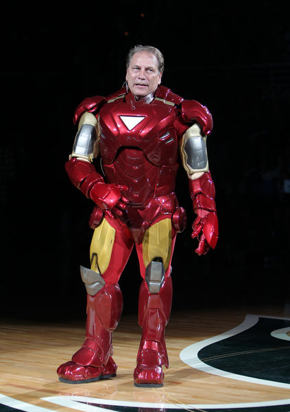 Michigan State University men's basketball coach Tom Izzo appears in an Iron Man costume Friday during the university's Midnight Madness basketball season kickoff event.