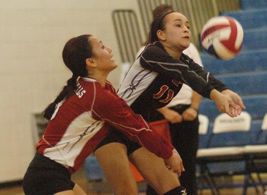 George Rogers Clark seniors Kaylee Raymer, right, and Amy Kao, left, prepare to return a serve during the Lady Cardinals¿ 3-0 loss to Campbell County in the 10th¿Region semifinals Wednesday night at Bracken County High School.