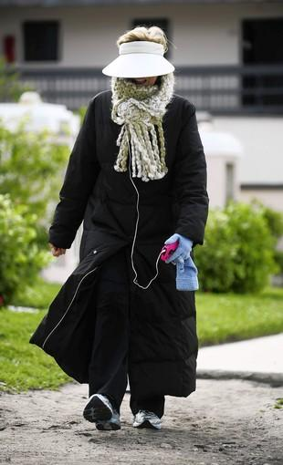 Donna Bechtold, a snowbird from Missouri, is bundled up for her morning walk on Ocean Blvd., in Deerfield Beach Sunday, Feb. 12, 2012.