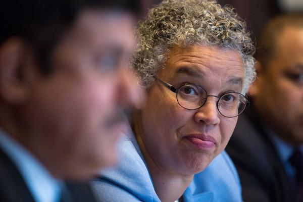 Cook County Board President Toni Preckwinkle listens to Dr. Ramanathan Raju, CEO of the Cook County Health and Hospitals System, talk to the Chicago Tribune Editorial Board about the budget.