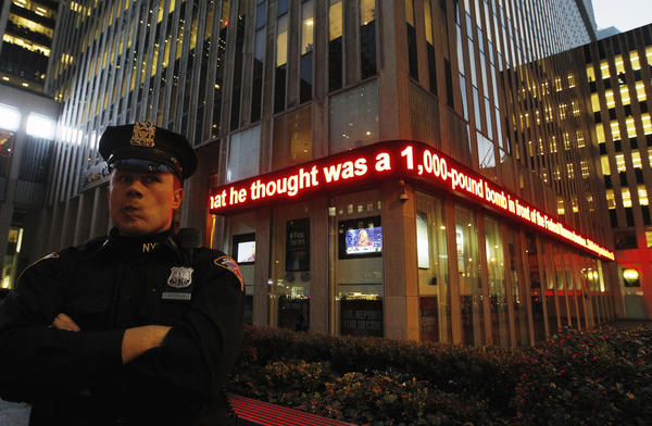 A New York Police Department officer stands in front of a news ticker mentioning the arrest of a Bangladeshi man during a sting operation in New York.The FBI on Wednesday arrested Quazi Mohammad Rezwanul Ahsan Nafis, 21, on charges he attempted to blow up the New York Federal Reserve Bank with what he believed was a 1,000-pound bomb.