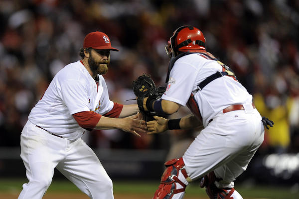 St. Louis Cardinals pitcher Jason Motte and catcher Yadier Molina celebrate defeating the San Francisco Giants in game three of the 2012 NLCS. The St. Louis Cardinals won 3-1.