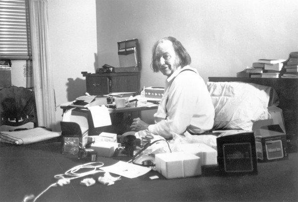 Author L. Ron Hubbard poses for a portrait in a room with a typewriter, a camera and various books and photography equipment on Jan. 10, 1982, in New York City.