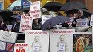 "<span style=""font-size: small;"">BELFAST, Northern Ireland (AP) — The first abortion clinic on the island of Ireland opened Thursday in downtown Belfast, unleashing angry protests on the street and uniting Catholic and Protestant politicians in calls to investigate the new facility.</span>"