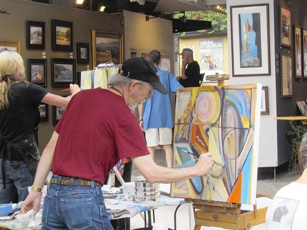 Artist Tom Swimm paints a picture at the Festival of Arts. The deadline to exhibit in the 2013 show is Oct. 26.