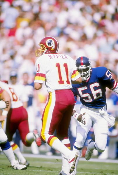 "Frequently referred to as the best linebacker to ever play the game, LT had absolutely no problem knocking a QB back into the Stone Age. Don't believe us? Google ""LT Theismann hit."" Nuff said."