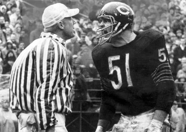 You're in a bar. After a few too many pints, you find yourself  talking some smack to a few people. Dick Butkus in this photo approaches you. Are you telling us you aren't immediately peeing your pants and bolting for the door? Exactly.