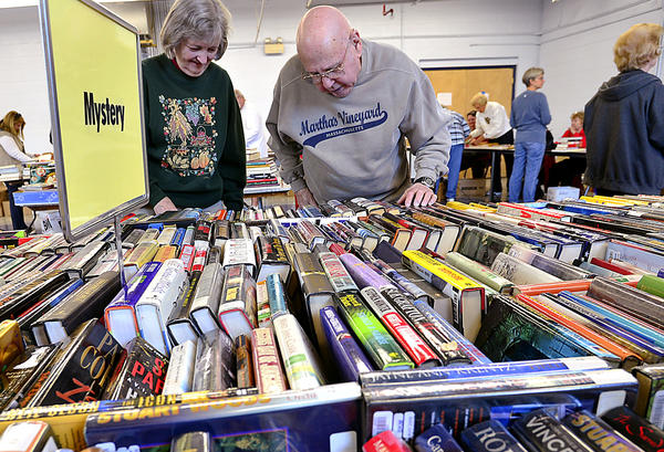 Nancy and Stoyan Russell of Hagerstown browse the large selection of books at the American Association of University Women fall used book sale Thursday at The Arc of Washington County in Hagerstown.