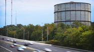 The giant gray cylinder has loomed over the North Baltimore landscape for decades, providing heating gas for city homes and a familiar landmark for drivers on the Jones Falls Expressway.