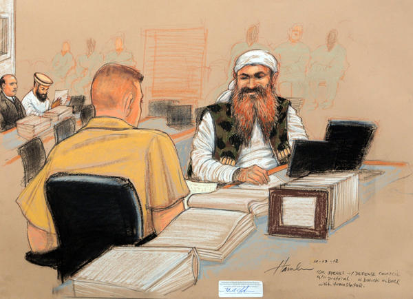 A courtroom sketch shows alleged Sept. 11 mastermind Khalid Shaikh Mohammed, right, speaking with a member of his legal team during a pretrial hearing at the U.S. military base at Guantanamo Bay, Cuba.