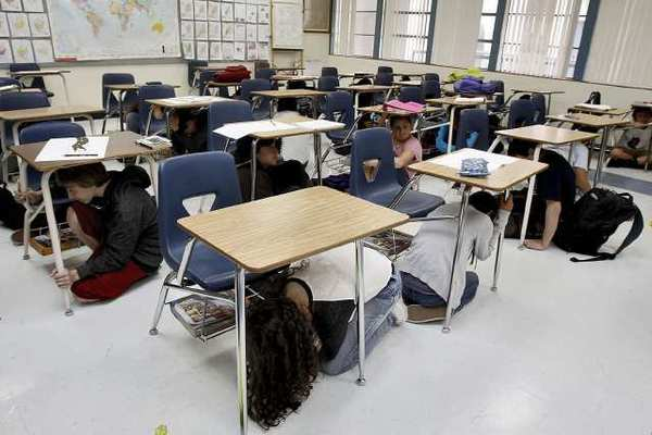 Christina Thomas' U.S. History class ducks and takes cover during the Great California Shakeout at Wilson Middle School in Glendale. The GCS is a yearly event that is a way to prepare for earthquakes.