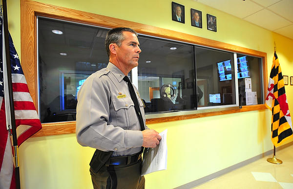 Maryland State Police Hagerstown barrack commander Lt. Tom Woodward speaks Tuesday about the security features of the new barrack building. Embedded inside the wall behind him is ballistic cloth and the window is bullet-resistant.