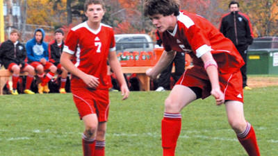 Conemaugh Township's Clayton Blough heads the ball while teammate Luke Meyers (7) looks on Thursday.