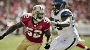Running back Frank Gore pounded Seattle's defense for 131 yards and the 49ers defeated the Seahawks 13-6 Thursday night to become the sole leader atop the NFC West.