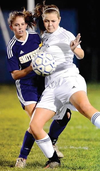 Williamsport's Carly Robinson, right, blocks off Smithsburg's Dominique Dilandro to get to the ball on Thursday during the first half of the Wildcats' 1-0 victory.
