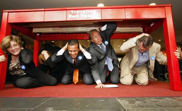 From left, Lucile Jones, Mayor Antonio Villaraigosa, Paul Schulz of the American Red Cross and MTA official Richard Katz drop under a table during the earthquake drill.