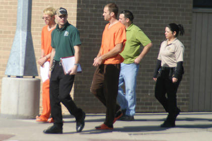 Inmates being escorted