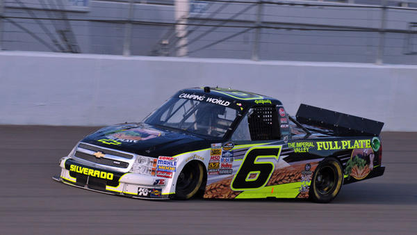 NASCAR truck driver Justin Lofton drives the No. 6 Eddie Sharp Racing Chevrolet with The Imperial Valley Full Plate Group sponsorship at a race a few weeks ago in Denver, N.C.