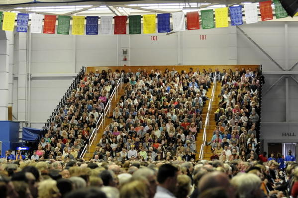 A strand of Tibeten prayer flags hang over the audience at the O'Neill Center at Western Connecticut State University during a talk by His Holiness the Dalai Lama.