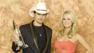 "<span style=""font-size: small;"">Carrie Underwood and her CMA Awards co-host Brad Paisley are beginning to put together their script for the upcoming 46th CMA Awards. Carrie tells us there's plenty of material for them to work with this year. ""Well there's always new songs, new artists up for nominations, new things that they have done...new political issues and this is an election year and we're right before the election, so I'm sure we'll be touching on that."" Brad and Carrie will host the CMA Awards for the fifth consecutive year. You can catch the show live from Nashville, November 1st at 8PM Eastern on ABC. Performers announced for this year's show include Carrie, Brad, Lady Antebellum,Brantley Gilbert, Eric Church, Kenny Chesney, Blake Shelton, Miranda Lambert, Little Big Town,The Band Perry, Kelly Clarkson and Zac Brown Band.</span>"