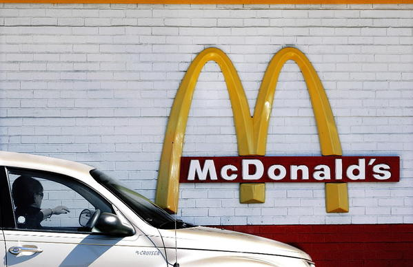 A customer moves through the drive up lane to place their order at a McDonald's restaurant in Springfield, Ill.