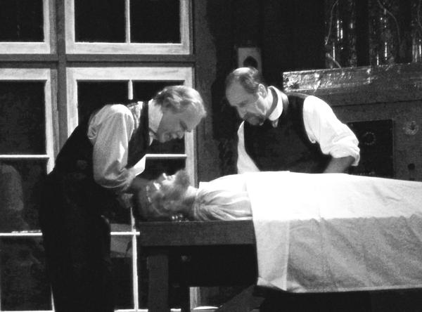 (Standing from left) Victor Frankenstein, played by Steve Spencer, and Henry Clervall, played by Dean Tahtinen, work to make the Creature in the Little Traverse Civic Theatres production of Frankenstein come alive.