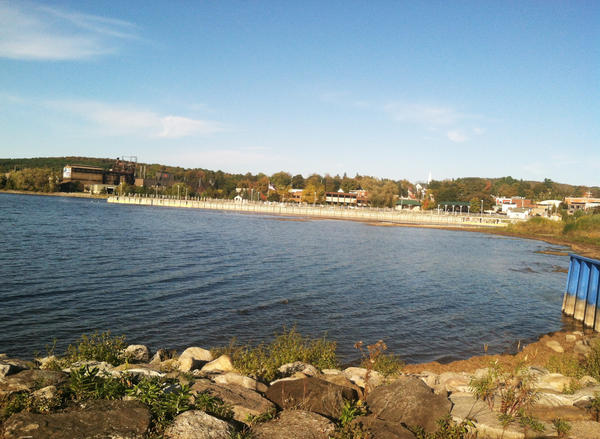 The City of East Jordan is working toward building a silt diversion wall between the Jordan River and its harbor in Lake Charlevoix, pictured here.