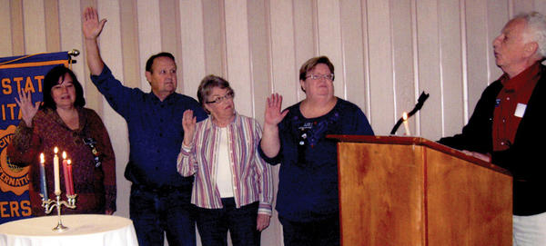 From left, Tri-State Civitan officers Theresa Rowe, Cliff Metger, Faye Metger and Jo Anne Hanahan are sworn in by Shelly Schwartz.