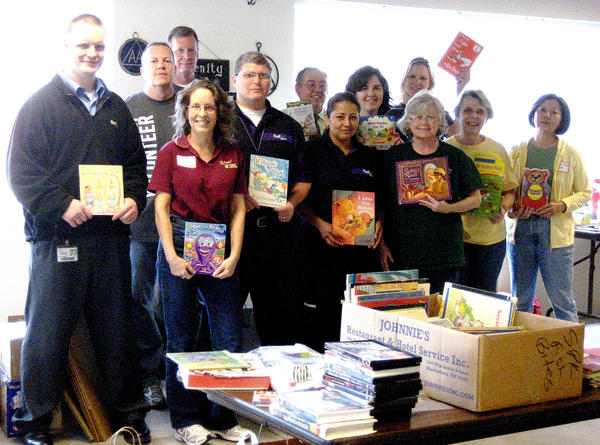 Participating in a day of book-sorting Oct. 10, were: Laura Wiedeman, First United Bank; Yesenia Quinones, FedEx driver; Kathleen O¿Connell, Washington County Library; Pat Wishard, Washington County Library; Lydia Byrne, Washington County Library; Brandon Grabenstein, FedEx; Chuck Eichelberger, First United Bank; the Rev. Gregg Meserole, Hagerstown Area Religious Council and Hagerstown Rotary Club; Richard Stover, FedEx driver; Jeff Ridgeway, Washington County Library; Carrie Plymre, Washington County Library; and April Krabal, First United Bank.