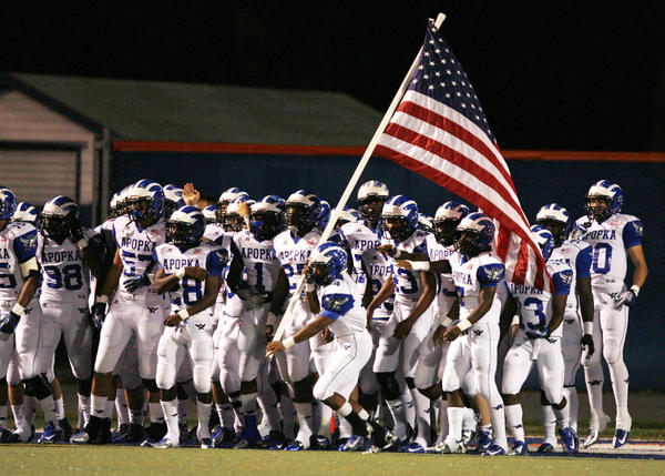 Apopka players run onto the field before the start of the Apopka High School at West Orange High School in Winter Garden on Thursday, October 18, 2012.