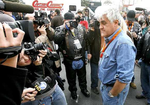 Jay Leno speaks to fans and reporters at the 24th annual Love Ride in Glendale.