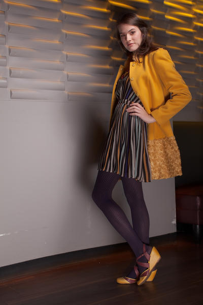 On Nicolette: BCBGeneration dress, Babe, $128; Insight Coat, Trillium, $188; Memoi tights, Ma Petite Shoe, $24; necklace, Bijoux, $225; BC wedges, Ma Petite Shoe, $80; Kate Spade earrings, Handbags in the City, $78. <HR>