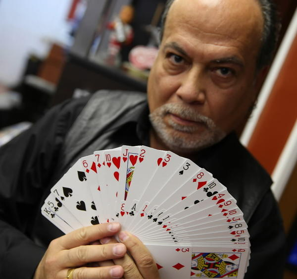 Cesar Juarez, a barber and a magician at the Mr. Barber of Chicago shop in the Gold Coast.