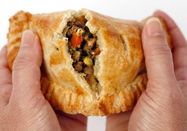 Curried lamb filling makes a great, savory hand pie. (Bob Chamberlin ...