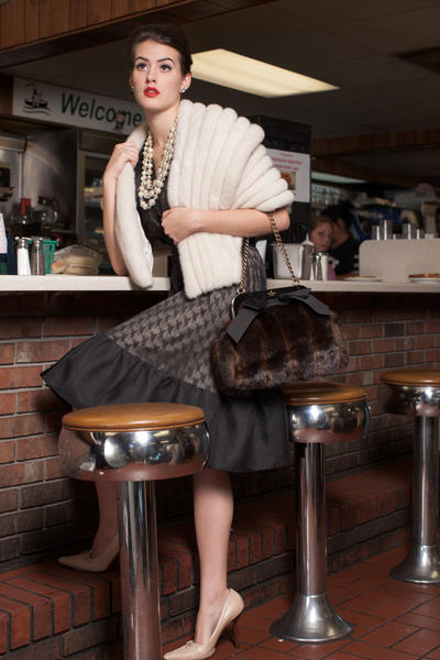 On Nicolette: Byron Lars dress, Trillium, $370; fur shawl, Mano Swartz, $11,000; Kate Spade purse, Handbags in the City, $378; Gucci pumps, Love Me Two Times, $150; vintage pearls, Bijoux Inspired Jewels, $285; Kate Spade ring, Handbags in the City, $78; Kate Spade studs, Handbags in the City, $38.